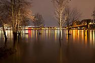 flood of the river Rhine on February 4th. 2021, the flooded meadow in the district Poll, trees in water, South bridge, Cologne, Germany.<br /> <br /> Hochwasser des Rhein am 4. Februar 2021, die ueberfluteten Rheinwiesen in Poll, Baeume stehen im Wasser, Suedbruecke, Koeln, Deutschland.