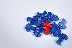 small gauge electrical wire connectors come in all shapes sizes and colors.  All displayed on a white background.