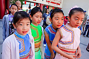 "14 FEBRUARY 2010 - PHOENIX, AZ: Girls watch a traditional performance during the Chinese New Year celebration in Phoenix, AZ. This marks the Chinese ""Year of the Tiger."" The Chinese New Year Celebration at the COFCO Chinese Cultural Center in Phoenix attracted thousands of people. The celebration featured traditional Chinese entertainment and food.  PHOTO BY JACK KURTZ"
