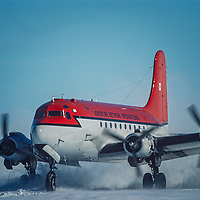 An aging DC-4 lands on the blue ice runway at Patriot Hills in the Ellsworth Mountains of Antarctica.