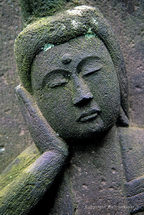 Closeup view of stone jizo (guardian) figure at Jyomyo-in (temple), Yanaka area, near Nippori station, Tokyo, Japan.