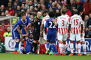 referee Anthony Taylor has words with Geoff Cameron of Stoke city as Diego Costa is left grounded after a tackle. Premier league match, Stoke City v Chelsea at the Bet365 Stadium in Stoke on Trent, Staffs on Saturday 18th March 2017.<br /> pic by Andrew Orchard, Andrew Orchard sports photography.
