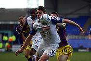 Tranmere Rovers' Ash Taylor (c) gets in front of Notts County's Jimmy Spencer. Skybet football league one match, Tranmere Rovers v Notts county at Prenton Park in Birkenhead, England on Saturday 15th March 2014.<br /> pic by Chris Stading, Andrew Orchard sports photography.