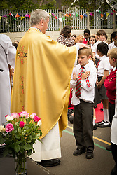 St Gilda's Catholic junior school centenary open air mass to celebrate 100th anniversary of the school.  The mass was taken by Bishop Crowley and Fr Sean. London Borough of Haringey May 2015 UK