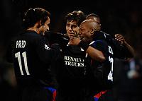 Photo: Daniel Hambury.<br />Lyon v PSV Eindhoven. UEFA Champions League. 03/08/2006.<br />Lyon's Sylvain Wiltord celebrates his goal with team mates.