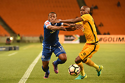 Supersports Thuso Phala is tackled by Chiefs MphahleleRamahlwe during the 2016 Premier Soccer League match between Kaizer Chiefs and Supersport held at theFNB Stadium in Johannesburg, South Africa on the 23rd November 2016Photo by:   Real Time Images