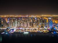 Aerial view of illuminated skyscrapers in Dubai at night, U.A.E.