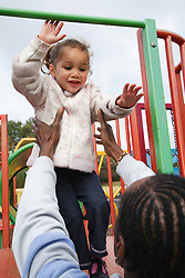 Man with child in playground