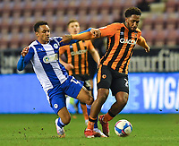 Hull City's Mallik Wilks battles with Wigan Athletic's Funso Ojo<br /> <br /> Photographer Dave Howarth/CameraSport<br /> <br /> The EFL Sky Bet League One - Wigan Athletic v Hull City - Wednesday 17th February 2021 - DW Stadium - Wigan<br /> <br /> World Copyright © 2021 CameraSport. All rights reserved. 43 Linden Ave. Countesthorpe. Leicester. England. LE8 5PG - Tel: +44 (0) 116 277 4147 - admin@camerasport.com - www.camerasport.com