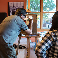 """Shawn Ahkeah paints """"Serenity"""" at Camille's Sidewalk Cafe Tuesday, May 28 during 2nd Look on 2nd Street."""