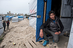 © London News Pictures. 29/04/2016. Calais, France.  17 year-old unaccompanied Afghan child refugee Muhammed in his living quarters in the calais Jungle. David Cameron has announced Britain will take in some child refugees living in camps inside the EU. Photo credit: Ben Cawthra/LNP