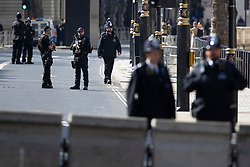 © Licensed to London News Pictures. 11/05/2021. London, UK. Armed police patrol Whitehall ahead of the state opening of Parliament . Photo credit: George Cracknell Wright/LNP