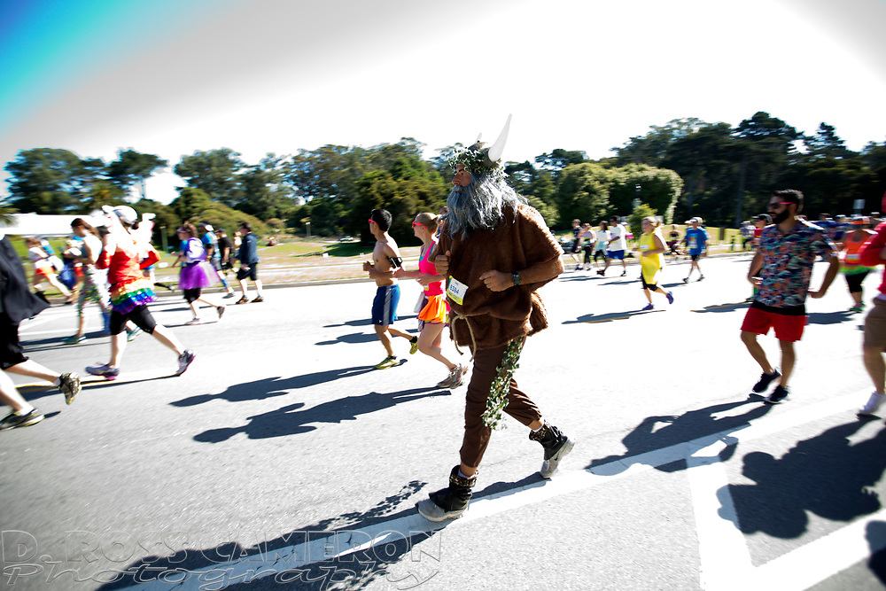 Costumed runners jog through Golden Gate Park during the 105th running of the Bay to Breakers 12k, Sunday, May 15, 2016 in San Francisco. The 7.42-mile race from San Francisco Bay to the Pacific Ocean, which attracts a field of tens of thousands of runners, from elite runners to weekend warriors, some clad in costume and some in nothing at all.  (Photo by D. Ross Cameron)