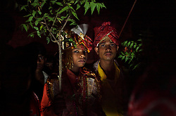 Giniaj, left, a young groom, is escorted to his marriage ceremony in Rajasthan, India on April 27, 2009.