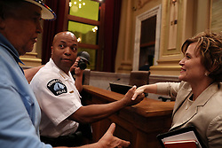 August 9, 2017 - Minneapolis, MN, USA - Acting police chief Medaria ''Rondo'' Arradondo shakes hands with Minneapolis Mayor Betsy Hodges as local activist Clyde Bellecourt, left, pats him on the shoulder following a public hearing by the Minneapolis City Council's Public Safety, Civil Rights and Emergency Management Committee on Arradondo's nomination to be the City's next police chief, on Wednesday, Aug. 9, 2017, at City Hall. (Credit Image: © Anthony Souffle/TNS via ZUMA Wire)