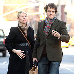 Heavy pregnant actress Claire Danes with her husband actor Hugh Dancy hail a cab on Sixth Avenue in Soho, New York City, NY, USA on December 11, 2012. The couple reportedly expecting a baby girl early next year. Photo by Charles Guerin/ABACAPRESS.COM  | 345395_004