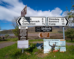 Road signs at Applecross on the North Coast 500 scenic driving route in northern Scotland, UK