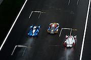 29th October - 1st November 2015. World Endurance Championship. 6 Hours of Shanghai. Shanghai International Circuit, China. Racing action between an Audi, Ferrari and LMP2 car