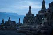 Stupas and Statue of Buddha, Borobudur, Kedu Valley, Yogyakarta, South Central Java, Java, Indonesia, Southeast Asia