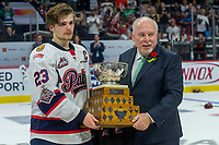 REGINA, SK - MAY 27: CHL president David Branch congratulates Sam Steel #23 of Regina Pats on earning the Memorial Cup tournament MVP against the Acadie-Bathurst Titan at the Brandt Centre on May 27, 2018 in Regina, Canada. (Photo by Marissa Baecker/CHL Images)