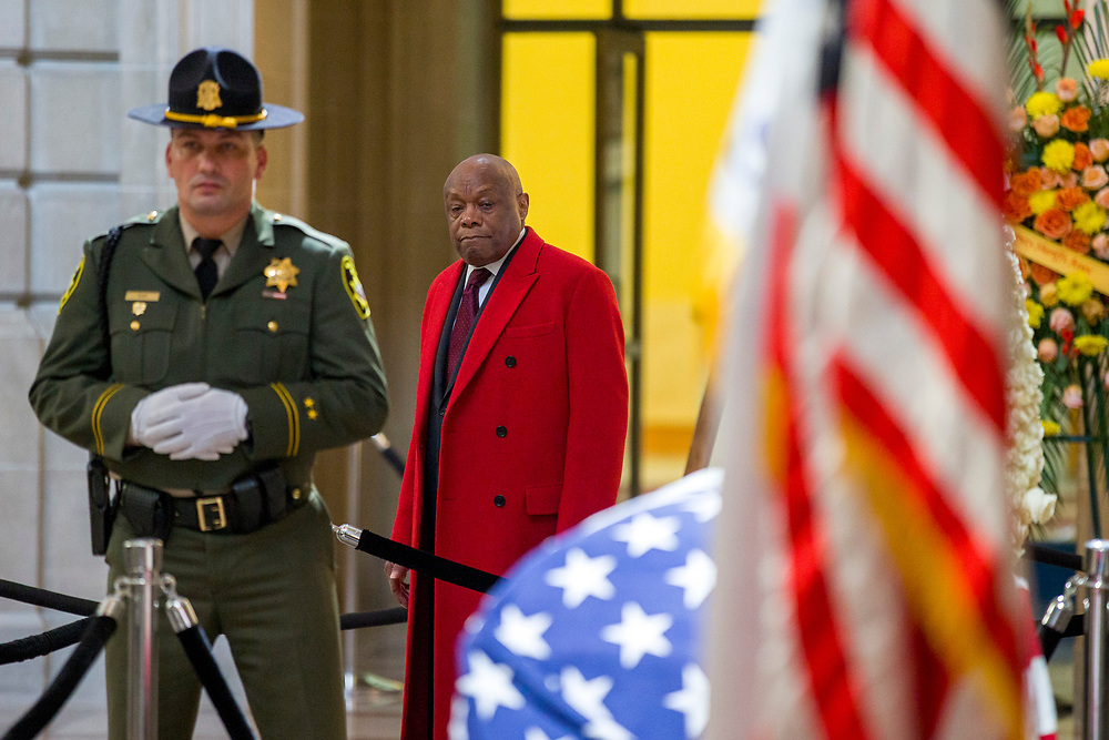 Willie Brown takes a moment as the body of San Francisco Mayor Ed Lee lies in state at City Hall on Friday, Dec. 15, 2017, in San Francisco, Calif. Lee died on Tuesday from a heart attack. He was 65 years old.