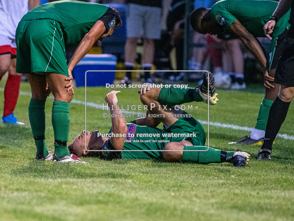 DARTFORD, UK - AUGUST 01: Phoenix Sports player lies injured on the grass during the pre-season friendly match between Phoenix Sports FC and Cray Wanderers FC at The Mayplace Ground on August 1, 2019 in Dartford, UK. <br /> (Photo: Jon Hilliger)