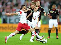 Fotball<br /> Polen v Tyskland<br /> 06.09.2011<br /> Foto: Witters/Digitalsport<br /> NORWAY ONLY<br /> <br /> v.l. Pawel Brozek, Toni Kroos (Deutschland)<br /> Fussball, Testspiel Polen - Deutschland 2:2