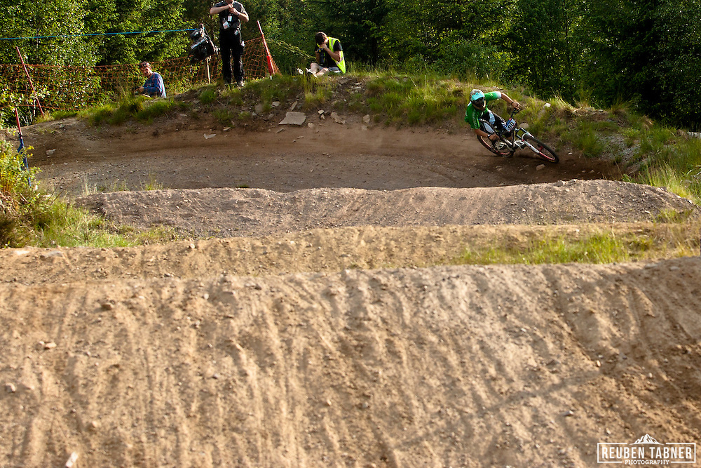Brook MacDonald of MS Evil Racing, flys down the course during the qualifying round of the 2010 Four Cross (4X) event at the UCI Mountain Bike world Cup in Fort William, Scotland.