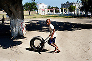 Ilha de Mozambique is an island located in the north of Mozambique. It was the first land colonized by the Portuguese, during the civil war was a safe place where to escape far from the war. Despite it was nominated world heritage by UNESCO, the conditions of the building are critical, several of them are abandoned or are collapsing. In the picture a boy playing in the street.