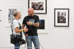 Michael Lichter being interviewed at his display of Limited Edition prints at the 2016 ROT (Republic of Texas Rally). Austin, TX, USA. June 11, 2016.  Photography ©2016 Garrett Stanley.