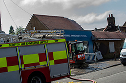 Pictured: Thomas Johnston Butchers in Brightons near Falkirk is destoyed by fire following a lightning strike during severe thunder and lightning storms that struck the central belt of Scotland overnight.   Andrew West/ EEm