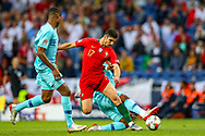 Portugal midfielder Conclamo Guedes (17) is tackled by Netherlands Defender Hans Hateboer  during the UEFA Nations League match between Portugal and Netherlands at Estadio do Dragao, Porto, Portugal on 9 June 2019.