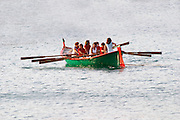 A group of women practicing rowing in an old fashioned rowing boat. Collioure. Roussillon. France. Europe.