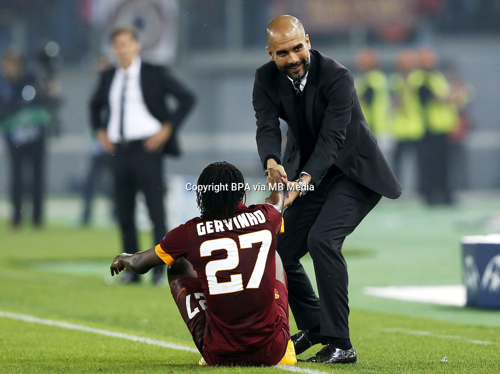 """Uefa Champions League-2014-2015 / Group E / <br /> As Roma vs Fc Bayern Munich 1-7  ( Olympic Stadium, Roma - Italy ) <br /> The Coach of Fc Bayern Munich - Josep """" Pep """" Guardiola (R) , helps the player of As Roma Gervinho to get up ,<br /> during the match between As Roma and Fc Bayern Munich"""