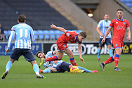 Coventry City defender Romain Vincelot tackles Oldham Athletic striker Daniel Philliskirk during the Sky Bet League 1 match between Coventry City and Oldham Athletic at the Ricoh Arena, Coventry, England on 19 December 2015. Photo by Alan Franklin.