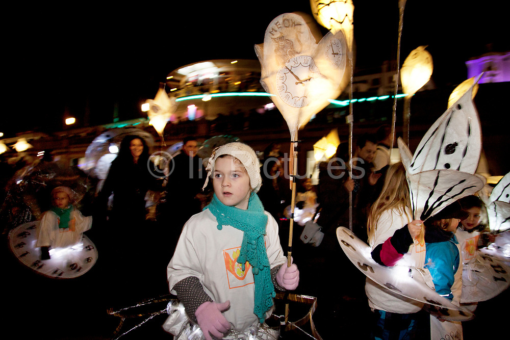 """Brighton, UK. Friday 21st December 2012. Burning the Clocks has been a Brighton tradition for almost two decades. This event takes place on the winter solstice, the shortest day of the year. A 2,000-strong parade winds its way through the streets and people pass their handmade paper and willow lanterns – filled symbolically with their hopes and dreams – into a blazing bonfire to """"burn the clocks"""" and welcome in the new longer day."""