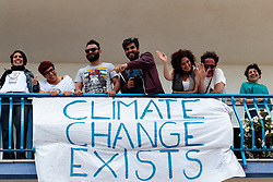 "27.05.2017, Taormina, ITA, 43. G7 Gipfel in Taormina, im Bild Demonstranten mit Banner ""Climate Change Exists"" am Balkon // Demonstrators with banner ""Climate Change Exists"" on the balcony during the 43rd G7 summit in Taormina, Italy on 2017/05/27. EXPA Pictures © 2017, PhotoCredit: EXPA/ Johann Groder"