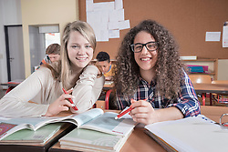 University students studying and smiling in classroom, Bavaria, Germany