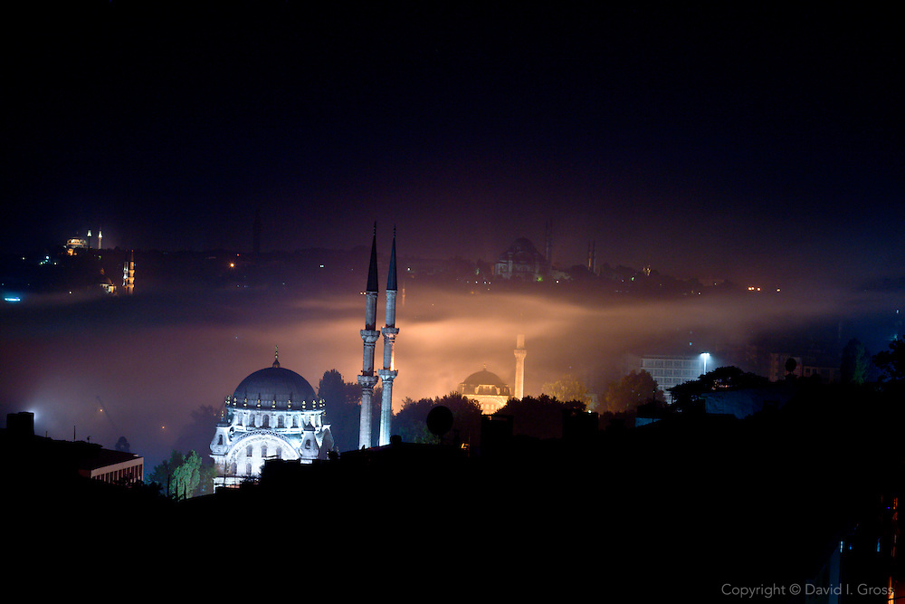 Istanbul at night as a fog rolls through from the Bosporus.