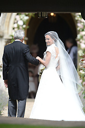 The Duchess of Cambridge's sister Pippa Middleton arrives with their father Michael Middleton, at St Mark's church in Englefield, Berkshire, for her wedding to her millionaire groom James Matthews at an event dubbed the society wedding of the year.