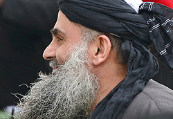 © Licensed to London News Pictures. 13/11/2012. London, UK Terror suspect Abu Qatada arrives home surrounded by media after he was released from jail following his dramatic victory against deportation. Photo credit : Stephen Simpson/LNP