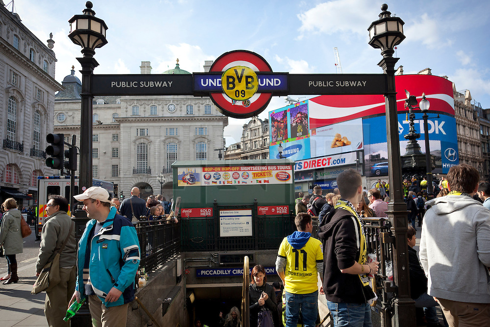 © Licensed to London News Pictures. 25/05/2013. London, UK. A Borussia Dortmund sticker is seen on the entrance to Piccadilly Circus underground station in London today (25/05/2013) as fans of Borussia Dortmund and Bayern Munich celebrate before their teams meet in the first ever all German Champions League final tonight. Photo credit: Matt Cetti-Roberts/LNP