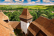 View of the church tower of the Szekly medieval fortified church of Viscri, Buneşti, Braşov, Transylvania. Started in the 1100's. UNESCO World Heritage Site .<br /> <br /> Visit our ROMANIA HISTORIC PLACXES PHOTO COLLECTIONS for more photos to download or buy as wall art prints https://funkystock.photoshelter.com/gallery-collection/Pictures-Images-of-Romania-Photos-of-Romanian-Historic-Landmark-Sites/C00001TITiQwAdS8<br /> .<br /> Visit our MEDIEVAL PHOTO COLLECTIONS for more   photos  to download or buy as prints https://funkystock.photoshelter.com/gallery-collection/Medieval-Middle-Ages-Historic-Places-Arcaeological-Sites-Pictures-Images-of/C0000B5ZA54_WD0s