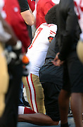 San Francisco 49ers quarterback Colin Kaepernick (7) takes a knee in protest as he refuses to stand during the playing of the National Anthem before the 2016 NFL preseason football game against the San Diego Chargers on Thursday, Sept. 1, 2016 in San Diego. The 49ers won the game 31-21. (©Paul Anthony Spinelli)
