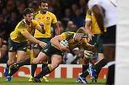 Australia's David Pocock pushes his way forward to score his 1st half try.  Rugby World Cup 2015 pool A match, Australia v Fiji at the Millennium Stadium in Cardiff, South Wales  on Wednesday 23rd September 2015.<br /> pic by  Andrew Orchard, Andrew Orchard sports photography.