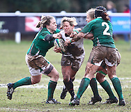 29 Feb 2010 Esher, Surrey: Claire Allan of England is tackled by Chris Fanning (2) of Ireland during the Women's Six Nations game between England and Ireland at Esher Rugby Club (photo by Andrew Tobin/SLIK images)