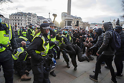 © Licensed to London News Pictures.03/04/2021. London, UK. 'Kill the Bill' protesters scuffles with police at Trafalgar Square, central London. The bill proposes new restrictions on protests during the Covid-19 coronavirus pandemic in England. Photo credit: Marcin Nowak/LNP