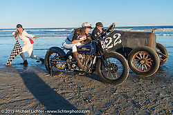 Brittney Olsen on the One of One Harley-Davidson (built by her husband Matt for Michael Detwiler)alongside Mel Stutz in Bobby Green's  Overland Whippet with Jessi Combs as the Flag Girl and Bobby Green as the starter as they all pose for painter David Uhl at The Race of Gentlemen. Wildwood, NJ, USA. October 11, 2015.  Photography ©2015 Michael Lichter.