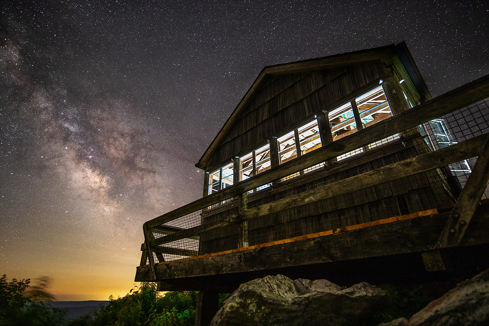 High above the low levels of light pollution in the mountains of southern West Virginia, the Milky Way can be seen bright and clearly on summer nights atop Peters Mountain from the Hanging Rock Raptor Observatory in Monroe County.