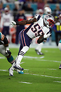 New England Patriots defensive end Eric Lee (55) twists his body as he chases the quarterback during the 2017 NFL week 14 regular season football game against the Miami Dolphins, Monday, Dec. 11, 2017 in Miami Gardens, Fla. The Dolphins won the game 27-20. (©Paul Anthony Spinelli)